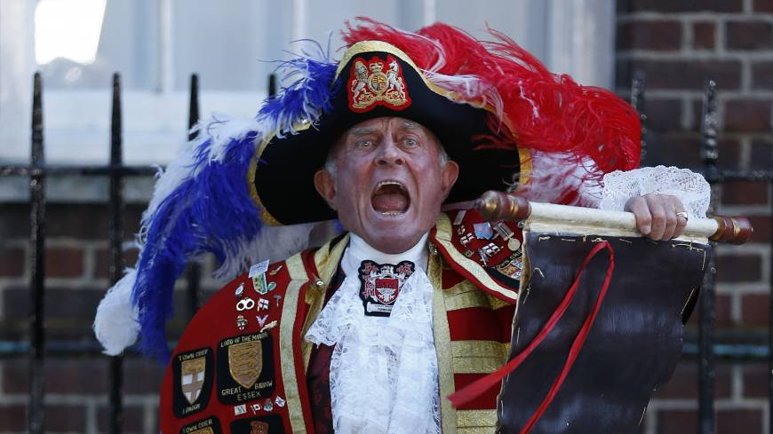 Hear ye, hear ye: Tony Appleton, a town crier,  announces the birth of the royal baby, outside St. Mary's Hospital exclusive Lindo Wing in London, on Monday.