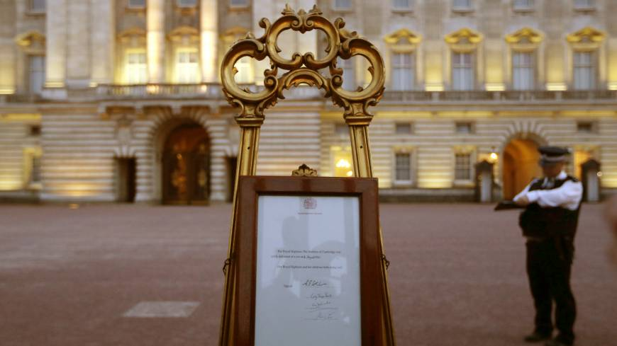Bundle of joy: A notice proclaiming the birth of a baby boy to Prince William and Catherine, Duchess of Cambridge, is displayed for public view at Buckingham Palace in London on Monday.