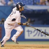 Swallows prevail over Carp in slugfest