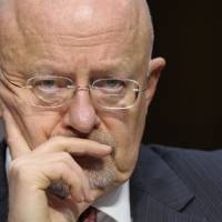 Under fire: Director of National Intelligence James Clapper listens to testimony at a Senate Intelligence Committee hearing where he testified about worldwide threats on March 12. | AP