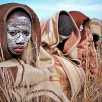 Rite of passage: Boys from the Xhosa tribe sit out in the open as part of a traditional circumcision ceremony near Qunu, South Africa, on Sunday.  The nation's first post-apartheid president, Nelson Mandela, grew up in Qunu. | AFP-JIJI