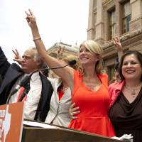 Hand in hand: Democratic state senators (from left) Kirk Watson, Wendy Davis, Leticia Van de Putte and Royce West participate in an abortion rights rally at the state Capitol in Austin, Texas, on July 1. | AP