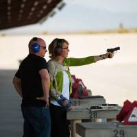 Responsible solutions: Former Rep. Gabrielle Giffords fires a gun for the first time since being shot in Arizona more than two years ago as her husband, Mark Kelly, watches at Clark County Shooting Complex at the kickoff of their Americans for Responsible Solutions tour in Las Vegas on July 1. The couple was traveling to seven states to promote safe gun legislation and chat with locals. | THE WASHINGTON POST