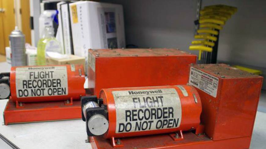 Telltale clues: The flight data recorder (left) and cockpit voice recorder from the Asiana Airlines jet that crashed in San Francisco are stored in Washington on Sunday.