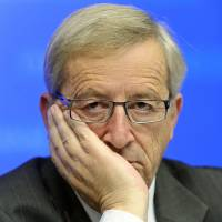 Veteran Luxembourg premier steps down over spy scandal
