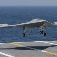 U.S. Navy lands drone on aircraft carrier for first time