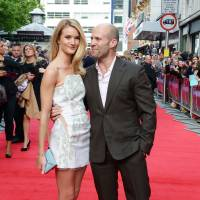 Action hero: Actor Jason Statham and Rosie Huntington-Whiteley arrive at the world premiere of 'The Hummingbird' at the Odeon West End in London on June 17. | AP