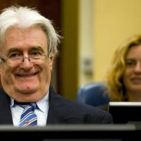 Yugoslav war crimes court reinstates genocide charge against Karadzic