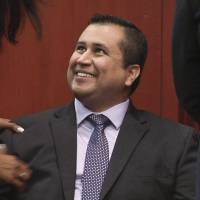 Acquitted: George Zimmerman smiles Saturday after receiving a not guilty verdict in his trial in Sanford, Florida. | AP