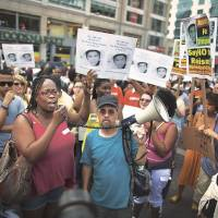 Public opinion: Demonstrators converge on Union Square in New York on Sunday to protest the acquittal of George Zimmerman in the killing of Trayvon Martin. | AP