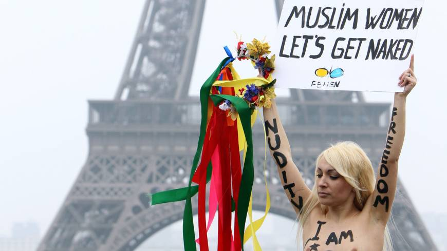 Inspirational figure: Inna Shevchenko, leader of the French branch of feminist movement Femen, holds a placard during a protest in front of the Eiffel Tower in Paris in March 2012.