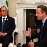 Advancing progress: Myanmar President Thein Sein meets with British Prime Minister David Cameron at 10 Downing Street, London, on Monday. | AP