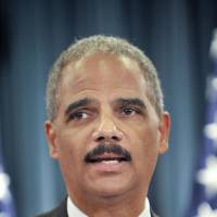 Holder decries self-defense laws