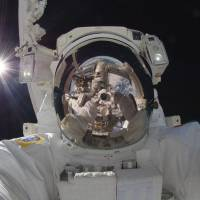 Space oddity: In December, astronaut Aki Hoshide took what might be the greatest selfie of all time at the International Space Station. The image encompassed the sun, the Earth, a robotic arm, a spacesuit and the darkness of the infinite beyond. | AP/NASA