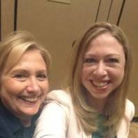 Say cheese!: Former Secretary of State Hillary Rodham Clinton (left) poses for a selfie with her daughter, Chelsea, in June. The practice has become so popular that the Oxford English Dictionary is monitoring the term 'selfie' as a possible addition. | AP