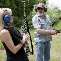 Nugent and his wife, Shemane, shoot guns on their Concord, Michigan, ranch on June 6. The Michigan property has a log cabin/hunting lodge, a shop where they keep their guns, guitars and a few vehicles, a lake with a boat, and numerous gun/bow and arrow ranges. | THE WASHINGTON POST