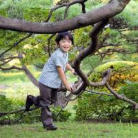 Imperial scion: Japan's Prince Hisahito smiles while playing at the Akasaka Palace in Tokyo in August 2011. | AFP-JIJI
