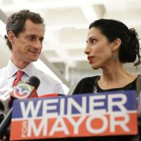 I'm with  Weiner: Huma Abedin stands alongside her husband, New York mayoral candidate Anthony  Weiner, during a news conference in New  York on  Tuesday. | AP