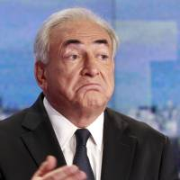 Derailed: Dominique Strauss-Kahn prepares for a TV interview in Paris in September 2011. | AP