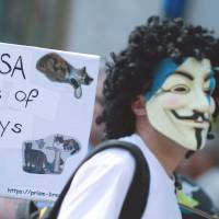 The cat's out of the bag: Protesters take part in a demonstration against the U.S. National Security Agency in Hanover, Germany, on Saturday. | AFP-JIJI