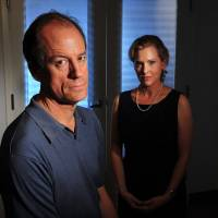The price of honesty: Thomas Drake, who once worked at the National Security Agency, is seen at the Government Accountability Project in Washington with Jesselyn Radack, GAP's director of national security and human rights. | THE WASHINGTON POST