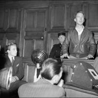 Man of the people: Self-declared first 'world citizen' Garry Davis (right) appears in a criminal court in Paris on Oct. 4, 1949. Also in the courtroom was Pierre Berge, a member of the Citizens of the World movement who later became a co-founder of the Yves Saint Laurent fashion house. | AFP-JIJI