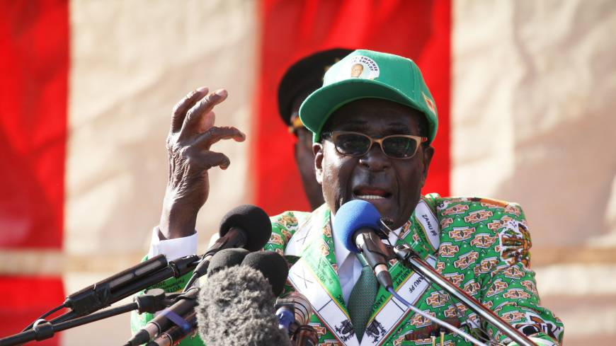 Rival rallies: Zimbabwean President Robert Mugabe delivers a speech at the launch of his party's election campaign in Harare on July 5.