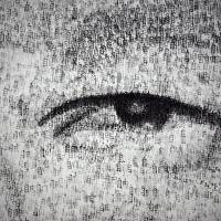 A close-up shows the individual punch marks in the portrait. | AFP-JIJI