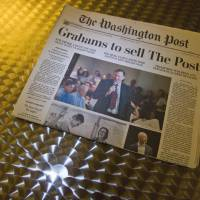 No joke: The front of The Washington Post is shown in Washington on Tuesday, a day after it was announced that Amazon.com founder and CEO Jeff Bezos had agreed to purchase the daily for $250 million. | AFP-JIJI