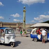 Going sightseeing: A tuk-tuk awaits fares near the Jardin des Tuileries in Paris in mid-July. The humble vehicle, a fixture in Asian cities from Bangkok to Bangalore, is rapidly becoming a common sight in the tourist sections of Paris. | AFP-JIJI