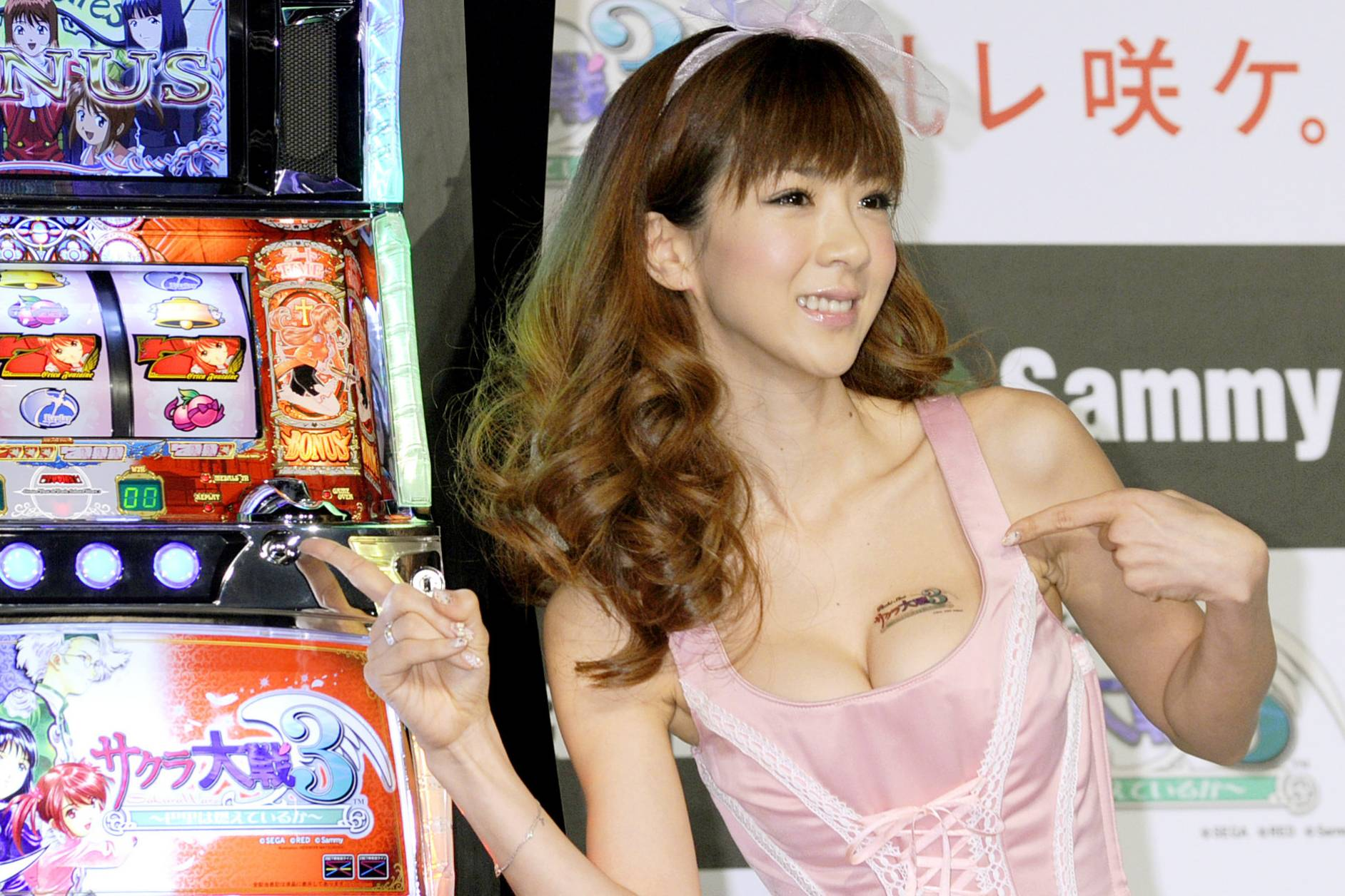 Jackpot: TV personality and popular campaign girl Aki Hoshino, seen here promoting a slot machine, reportedly received 300,000 from World Auction to write on her blog that she'd bought an air filter from the site. | KYODO