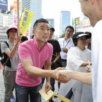 Yes he can: Winning Tokyo candidate Taro Yamamoto campaigns in Shinjuku Ward last month. | KYODO