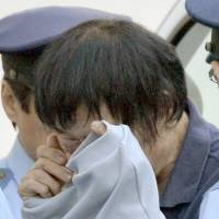 The accused: Kosei Homi, who allegedly murdered five people in Shunan, Yamaguchi Prefecture, is escorted to a police station July 27. | KYODO