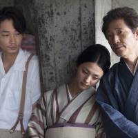 Affairs of the heart: Tomoko (Hikari Mitsushima) is forced to choose between young lover Ryota (Go Ayano, left) and married older man Shingo (Kaoru Kobayashi, right) in 'Natsu no Owari (The End of Summer).' | © 2012 Eiga
