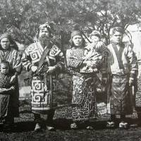 Righting historical wrongs: A group of Ainu are captured on film in 1904, during a period when large numbers of sets of Ainu remains were unearthed by Japanese archaeologists for research and display at universities across the country. | WIKIMEDIA COMMONS