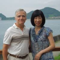 Life's a beach: Bill and Michiko Achilles pose together on the veranda of their beach house in Minamiboso, Chiba Prefecture. | MAMI MARUKO