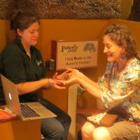 Furry friend: Katie Adler (right) gets up close and personal with a tarantula at the Butterfly Pavilion in Westminster, Colorado, during a recent video shooting for her website. | GEORGIA MANNING