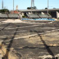 Pitch battle:  Twenty-two 30-gallon (114-liter) drums containing dioxin-tainted residue were unearthed at this site in Okinawa City. The land, once part of the U.S. military's Kadena Air Base, was used as a soccer pitch for more than a decade. | JON MITCHELL