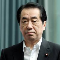 Top man: Then-Prime Minister Naoto Kan addresses  reporters July 13, 2011. | BLOOMBERG