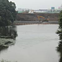 Making way for the new: Land being prepared up to the edge of a pond in Chiba New Town Masako Tsubuku