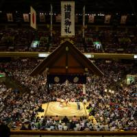 Bird's-eye view: Sumo wrestlers battle it out in Tokyo's Kokugikan Sumo Stadium. | JASON JENKINS PHOTO
