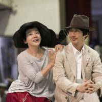 Family issues: As director Keralino Sandorovich leads the cast in a rehearsal of Russian dramatist Anton Chekhov's 'The Seagull' last week, actress Shinobu Otake (left) cozies up with lead actor Mansai Nomura. | TAKASHI KATO