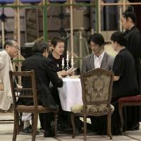 Actors Takehiko Ono (left, who plays retired General  Ilya Shamrayev), Otake and Nomura run through a dinner scene with other cast members. | TAKASHI KATO