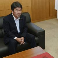Not so fast: Industry minister Toshimitsu Motegi and consumer affairs minister Masako Mori appear Thursday before a meeting to order Hokkaido Electric Power Co., Tohoku Electirc Power Co. and Shikoku Electric Power Co. to trim their planned household rate hikes. | KYODO