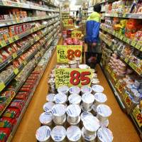 On the rise: A customer walks through the noodles section at a supermarket in Tokyo in April. | KYODO