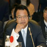 All ears: Akira Amari, the Cabinet minister in charge of TPP negotiations, attends talks Thursday in Brunei as the 19th round of free trade discussion begins. | KYODO
