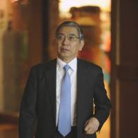 Positive: Bank of Japan Gov. Haruhiko Kuroda arrives at the Jackson Hole economic symposium in Wyoming on Thursday. | BLOOMBERG