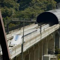 Refloated: A magnetically levitated train developed by Central Japan Railway Co. (JR Tokai) runs on an experimental track in Tsuru, Yamanashi Prefecture, on Thursday. | KYODO