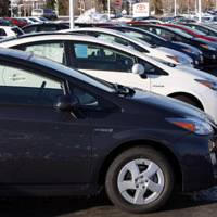 Hybrid hive: 2010 Prius sedans sit at a Toyota dealership in Lakewood, Colo., on Dec. 27. | AP PHOTO