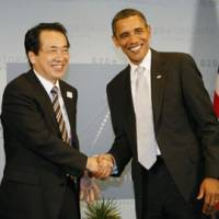 Center stage: Prime Minister Naoto Kan shakes hands with U.S. President Barack Obama in Toronto in June. | KYODO PHOTOS